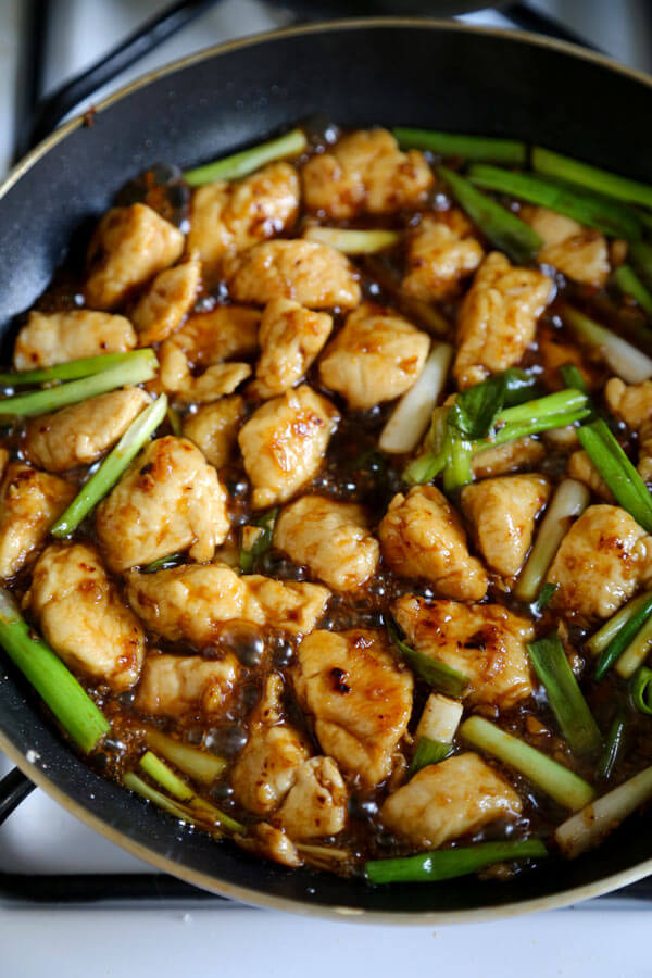 Better than takeout Mongolian Chicken Recipe ready in 15 minutes! Tender chicken pieces & scallions cooked in a sweet & savory brown stir fry sauce.