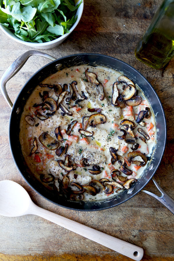 Simple and rustic Cream Of Mushroom Chicken with chopped carrots, fresh mushrooms & thyme. Family friendly and ready in under 20 minutes!