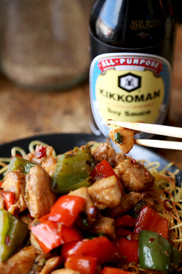 Kung Pao Chicken Recipe - Celebrate Chinese new year with this traditional and delicious kung pao chicken recipe! Served on crispy noodle cakes, it's a fun and colorful meal to enjoy with friends and family!   pickledplum.com