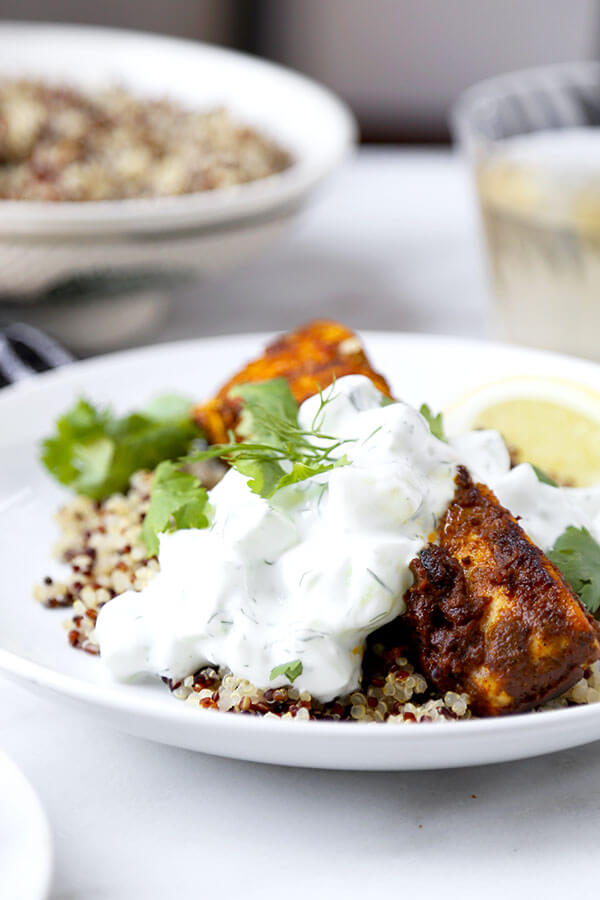 Salmon Tikka Over Quinoa - Put dinner on the table in 15 minutes with this smoky Salmon Tikka Over Quinoa Recipe, served with a cooling cucumber raita! Recipe, fish, salmon, healthy, main, dinner, curry | pickledplum.com