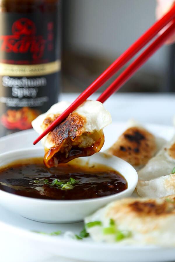 Shrimp Gyoza (Pan-Fried Dumplings) - Pillowy and tender pan-fried shrimp gyoza served with a fiery Szechuan spicy sauce. Recipe, dumplings, appetizer, snack, shrimp, gyoza | pickledplum.com