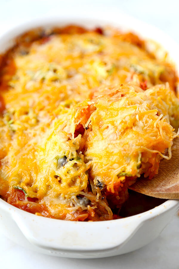 Mexican Spaghetti Squash Casserole - With the colors of autumn and peppy, south-of-the-border flavor, this Mexican Spaghetti Squash Casserole With Avocado Salsa Recipe is healthy dinner perfection! Recipe, healthy, dinner, main, casserole | pickledplum.com