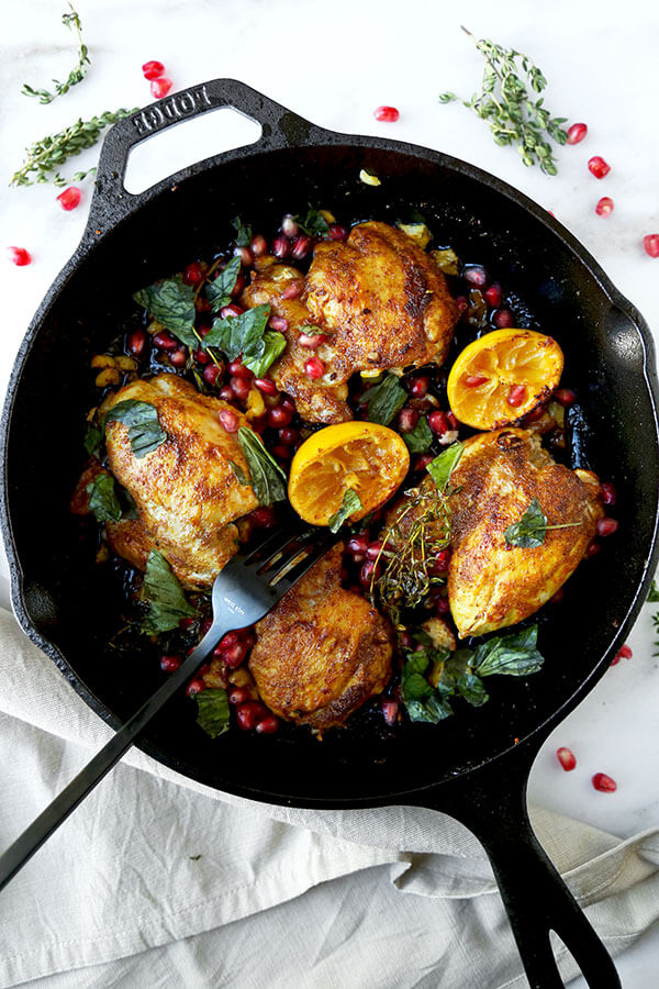 Curried Chicken With Pomegranate - Juicy curried chicken served with fresh basil, pomegranate and loads of pan fried garlic bits. Amazing and so easy! Ready in less than 25 minutes. Recipe, chicken, poultry, curry, dinner, easy meal, pomegranate, lemon | pickledplum.com