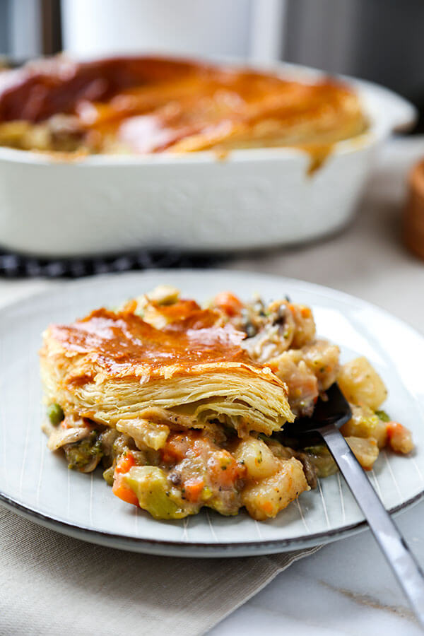 Hearty Vegetable Pot Pie - This hearty vegetable pot pie with creamy mushroom sauce and topped with puff pastry is guaranteed to keep you warm this winter! Recipe, dinner, vegetables, baking, pie   pickledplum.com