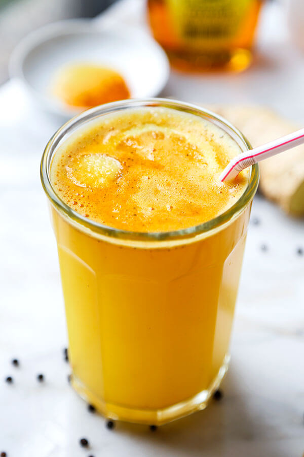 Morning Wellness Tonic - Add a little zing to your morning with this spicy, cleansing and invigorating wellness tonic! Recipe, drink, healthy, turmeric, ginger, breakfast | pickledplum.com