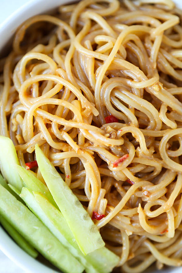 Chilled Sesame Noodles - Delicious eggs noodles tossed in a nutty, spicy and sweet sesame sauce. Ready in 15 minutes from start to finish and so much better than delivery! Recipe, noodles, main, Chinese, egg noodles | pickledplum.com
