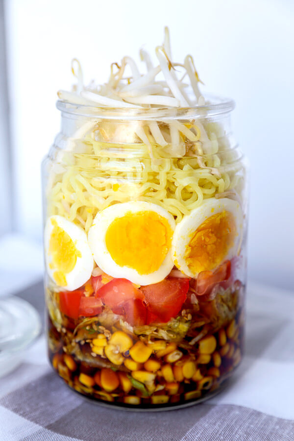 Ramen Noodle Salad - This a quick and delicious chilled ramen noodle salad tossed with fresh tomatoes, corn, lettuce, eggs and bean sprout and dressed in a sweet vinegar and sesame dressing. Recipe, ramen, vegetarian, healthy, salad, noodles, easy dinner recipes | pickledplum.com