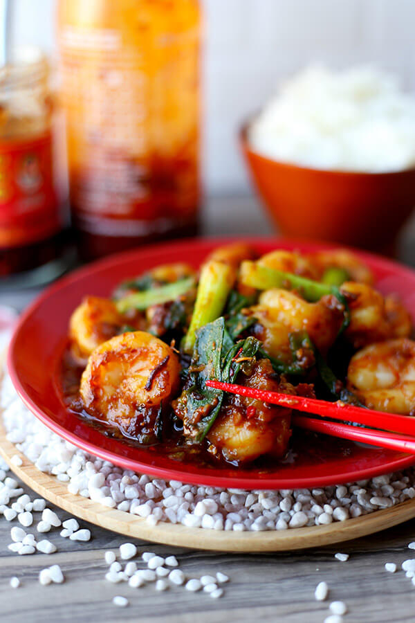 Garlic Shrimp With Chili Crisp - This garlic shrimp recipe is nothing like you've ever tasted before! We've the taken the classic recipe and turned it upside down to bring garlic shrimps that are smoky, salty, nutty and with just enough heat to make you reach for a spoonful of rice. It's insanely delicious! Recipe, shrimp, stir fry, Chinese food, easy recipe   pickledplum.com