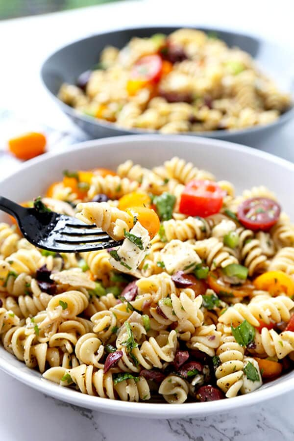 Italian Pasta Salad - Serve this bright, sweet and tangy Italian pasta salad at your next barbecue. It's the perfect summer salad filled with veggies, black olives, turkey and cheese, with a homemade Italian dressing so delicious you'll want to use it on everything! Recipe, salad, healthy pasta salad, tomato salad | pickledplum.com