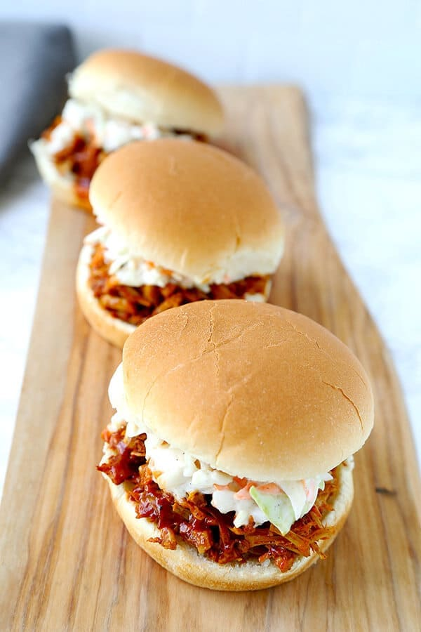 Barbecue Pulled Jackfruit Sandwiches - Skip the meat, extra fat and calories with a dreamy barbecue pulled jackfruit sandwich. This smoky, sweet and tangy sandwich is proof that plant based food can be just as delicious as the real thing! plant based recipes, vegan sandwich recipes, healthy vegan recipes, healthy super bowl recipes | pickledplum.com