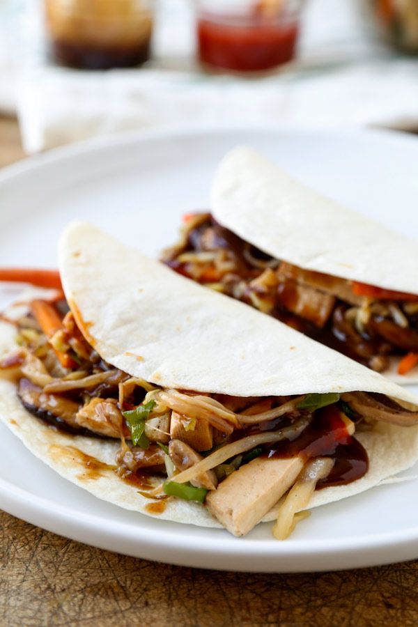 Mu Shoo Tofu Recipe - This post is a healthy vegetarian moo shu tofu, packed with vegetables and tossed in a sweet and savory sauce. You can use tortillas or lettuce wraps to act as a pancake for this quick stir fry. Homemade Chinese Food made healthier and ready in just 20 minutes! #chinesefood #stirfry #healthyeating #vegetables #tofu | pickledplum.com