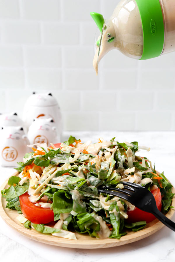 Creamy Tofu Ginger Salad Dressing (Vegan) - This is a quick and easy vegan creamy tofu salad dressing that's gingery, tangy and a little sweet. Ready in just 5 minutes! #veganrecipes #vegetarian #glutenfree #saladdressing | pickledplum.com